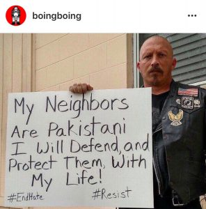 Photo of Veteran holding a sign stating support for Pakistani neighbor