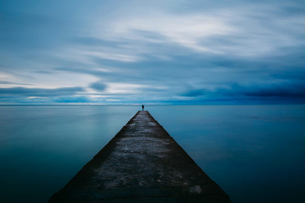 Image of person alone on a dock.